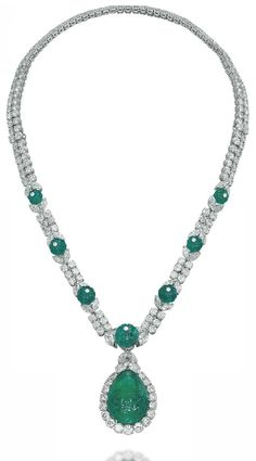 AN EMERALD AND DIAMOND NECKLACE, BY VAN CLEEF & ARPELS  The detachable pendant set with a drop-shaped carved emerald weighing approximately 18.90 carats, in a brilliant-cut diamond surround, to the marquise-shaped diamond surmount, suspended from a brilliant-cut diamond twin-line necklace, enhanced at the front with graduated fluted emerald beads flanked on either side with marquise-shaped diamonds