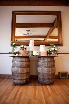 wine barrel cake table...ew I like this!  I need to find out where you get these wine barrels, I'd love to plant flowers in some in my backyard!