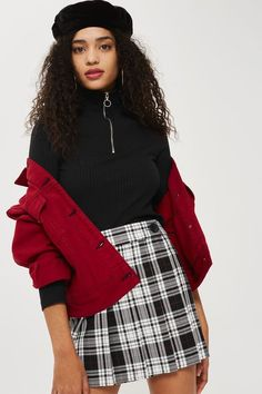 The kilt gets a minimal update with our modern design. In a black and white heritage check this design is chic and versatile. Style it with a cute roll neck and jacket combo for a stylish look.