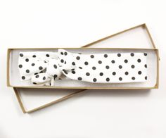 Polka Dot Organic Cotton Knotted Headband/ Infant Headband/ Toddler Headband/ Black White Headband Forget the lace and ruffles -- your little one will be stylin in these super-soft knotted headbands-- so comfy she wont ever want to take them off! Get ready for the compliments to roll in as your little one models super-modern patterns that are just as unique as she is! This listing includes: (1) Black and white polka-dot Each of our stretchy 100% organic knit headbands patter...