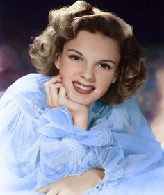 "She changed her name to Judy Garland, a hybrid of the popular song ""Judy"" and ""Garland"" after the famous movie critic Robert Garland. Description from mikeb63.blogspot.com. I searched for this on bing.com/images"