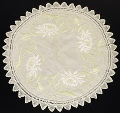 """261.Arts & Crafts round mat, unknown maker and number, ca. 1908-1913, green, yellow and white floss on off white linen fabric, padded satin stitch and French Knots, conventional floral motif, Art Nouveau influence, 26""""dia., excellent condition 250-350"""