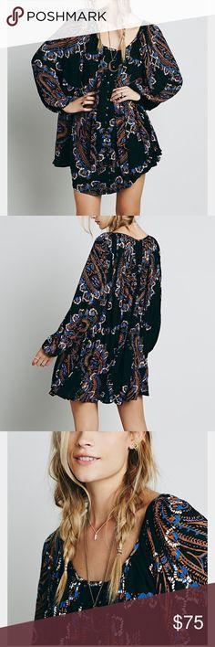 Free People peasant Printed mini dress Brand new with tags. Black medium. Oversized fit Free People Dresses