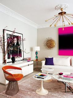 Living Room Luxe. Neutral interior with bright pink abstract art.