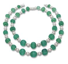 TWO MAGNIFICENT FLUTED EMERALD BEAD AND DIAMOND NECKLACES   Comprising seventeen and fifteen fluted emerald beads weighing a total of 786.22 carats, measuring from 10.5 to 20.2 mm diameter, with pavé-set diamond sphere and rondelle spacers, 48.0 and 40.4 cm long