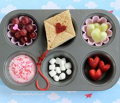 Muffin trays w/cute paper cups for each person to put their food in.