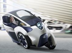 Toyota i-Road is like a cross over from BMW covered scooter and the MP3 Piaggio. Note the smile on the pilots face.
