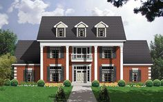 A grand two story entrance with curved stairs graces this 4 bedroom Southern colonial home.  House Plan # 371065.
