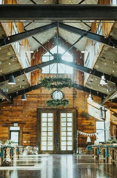 rows of candle lit tables pastel rose floral arrangement centerpieces rustic wedding decor wood cabin walls wood reception tables salt lake city utah northern utah professional wedding photographer #northernutahweddingphotographer #saltlakecityphotographer #weddingphotos #weddingday #saltlaketemple #utah #marriagegoals #lds #professionalutahvalleyphotographer #outfitinspo #knotandpinealpinebarn