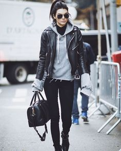 rainy LA day outfit inspo via #kendalljenner wearing @unravel_project hoodie + #givenchy satchel #ootd