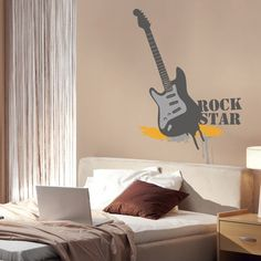 Is your child or teenager a rock star wanna-be? Does your kids lovse music? This rock star vinyl wall sticker is the perfect wall decor to create musical scene in your kids rooms and play rooms. This giant guitar wall sticker features guitar wall sticker with the Rock Star wording.$74.95