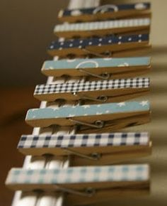 Clothespins and mod podge... I just did this with pages cut from a book. very cute.