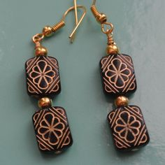 Black and Gold etched dangle earrings by Momsawrapstar on Etsy https://www.etsy.com/listing/232724445/black-and-gold-etched-dangle-earrings