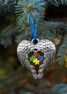 Every child deserves their own guardian angel -- especially our beloved children with autism. The colorful puzzle piece of autism awareness is framed within the sweep of two angel wings on our touching Christmas ornament.