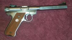 My wifes 22LR Ruger target pistol. She's very accurate with it.