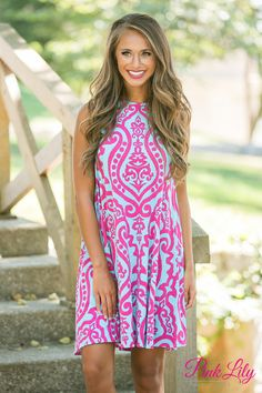 Our damask collection has been your favorite for ages - and we are so happy to bring you some new additions that you're sure to love! This gorgeous little dress features a vibrant aqua and hot pink damask print for a bold way to celebrate any occasion! It's also sleeveless, flares out from the bust for a breezy look, and has pockets on each side to make this a comfortable and practical choice!