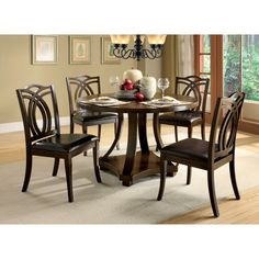 Dine in style with this five-piece dining set from Kamiko. This set features a dark oak finish, elegant flared legs, and an eye-catching table base. Crafted from solid wood, this furniture is sure to complement your dining experience for years to come.