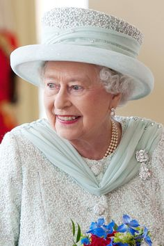 """Another brooch created from the famous Cullinan diamond, the affectionately-named """"Granny's Chips"""" - it originally belonged to her grandmother Queen Mary - features the Cullinan III, a pear-shaped 94.4-carat diamond, suspended from the square-cut 63.6-carat Cullinan IV diamond. Here the Queen is seen wearing it on the final day of her Diamond Jubilee celebrations in London."""