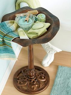 Put a birdbath to work as a tub-side table, holding bath soaps, salts, and hand towels..love this idea.