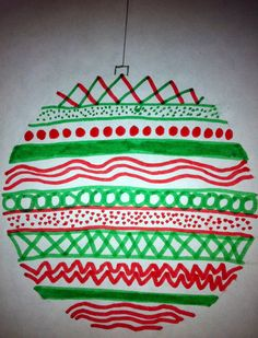 The 8th grade class created Christmas ornaments using different types of lines to create a design. The ornaments have no drawn outline, the ...