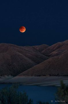 9-2015  Blood moon above Lucky Peak reservoir. (A rare combination of a super moon and an eclipse.) Photo by Tim Tower