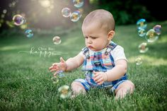 6 month old boy playing with bubbles on the lawn at dusk Glastonbury CT baby photography Onebighappyphoto.com/babies