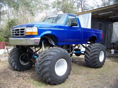 massive blue lifted Ford Monster F-150 truck