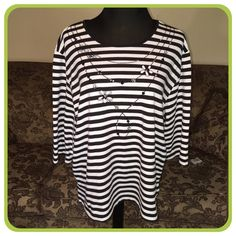 Alfred Dunner Top Black and white stripe embellished with beads and sequins.  Great condition.  It was only worn a couple of times.  Super cute with black shorts or capris. Alfred Dunner Tops