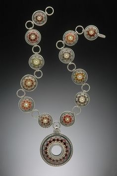 Kristina Logan. Lampworked glass beads set in sterling bezels.