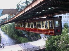 wuppertal, germany- hanging trains. oldest monorail system in the world, built in 1901.
