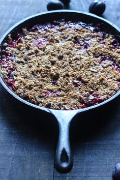 a Fall crisp with plums, vanilla and cardamom topped with crunchy rye, oats and hazelnuts
