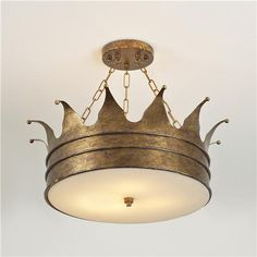 "Crown Ceiling Light 3 finishes!  Our exclusive crown ceiling light will delight the king, queen or princess in your life! With our special antiqued metallic gold finish and dainty chains, this fixture throws a star shaped pattern of light on your ceiling and softened light down into the room.The white acrylic diffuser makes changing the bulbs easy! 3x40 watts. (15""Hx15""W)"