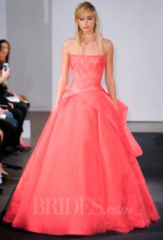 Brides: Vera Wang - Fall 2014. Coral strapless silk ball gown wedding dress with hand applique Chantilly lace, gauze draping and floral beaded embroidery, Vera Wang