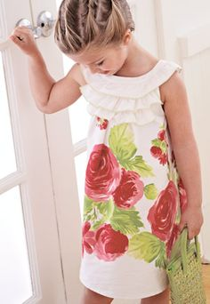 ruffles with rounded neck...wonder if I can make this in my size?!