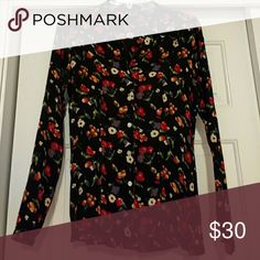 Cute floral patterned blouse Gap floral buttoned blouse with open collar back is slightly fitted for better curves. GAP Tops Blouses