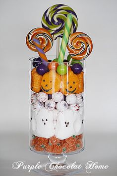 Lots of great ideas at this site including this Halloween centerpiece. Swap out the pumpkins for other candy to make it suitable for other occasions.  Peeps for Easter?