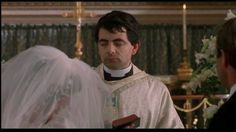 """Nervous trainee priest (Rowan Atkinson), """"Four Weddings and a Funeral"""" (1994)"""