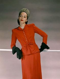 1941 --- Standing model wearing vermilion wool jersey suitdress, tied at the waist, ocelot off-the-face pillbox, black gloves, and shoes. vintage everyday: Extraordinary Color Fashion Photography Taken During the by John Rawlings Madame Gres, Elsa Schiaparelli, Pierre Balmain, 1940s Fashion, Vintage Fashion, Vintage Glam, Vintage Inspired, Vintage Style, Lanvin