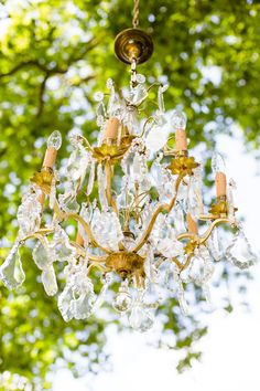 In love with this golden chandelier! On Style Me Pretty: http://www.StyleMePretty.com/destination-weddings/2014/02/21/grayed-jade-sophisticated-garden-wedding-ideas/ Photography: Eddie Judd