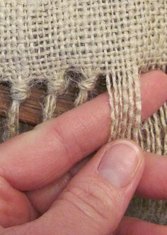 Tying Burlap edges. Perfect for those burlap placemats I want to make.