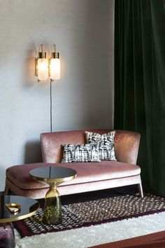 Studiopepe at Spotti Milano. Love the way the light catches the velvet sofa, and the pink and bottle green.