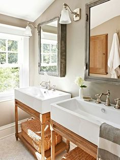 Modern Chic Bathroom with Industrial medicine cabs....love the sinks, etc.