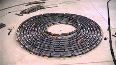 Here's one of the most interesting model trains you'll ever see. It's a fast, endless bi-directional spiral. It's amazing, but it might make you a little sleepy to watch it. Enjoy this fascinating model train.