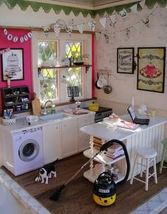 Kitchen in country/shabby style.  The laptop has a picture of cupcakes on the screen as if searching for ideas.