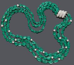 "EMERALD AND DIAMOND SAUTOIR, BY SUZANNE BELPERRON, ca. 1960.  Platinum 950 and white gold 750, total 131g.  Comprising three rows of graduated, fine, baroque emerald beads, spaced by 17 diamond-set boules totalling ca. 4.00 ct. Clasp set with 85 brilliant-cut diamonds of ca. 5.00 ct, makers mark ""DF"" for Darde et Fils. L ca. 63,5 cm."