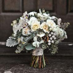 Winter wedding bouquet -- Roses, fir branches, dusty miller, brunia berries, eucalyptus, pine cones