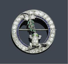 *SAPPHIRE, EMERALD AND DIAMOND BROOCH, ca. 1925. Platinum und yellow gold 750. Charming, circular brooch set throughout with 30 old European-cut diamonds weighing ca. 3.00ct, additionally decorated with a sapphire-set border and 2 cut onyx parts. Koller Auctions, Jewelry Auction, Zurich Switzerland, Sept 20th