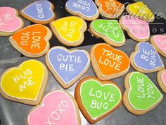 Sugar cookies decorated like Sweetheart candies for Valentine's day