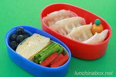 Contents of preschooler bento lunch: Vegetable gyoza with dipping sauce, blueberries, tamagoyaki (Japanese rolled egg, see my tutorial), and sauteed asparagus and red bell peppers with vinaigrette dressing.