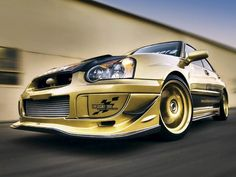 Interesting gold/bronze colored custom Subaru Impreza. Dig the monochromatic paint on body and wheels (nice touch).